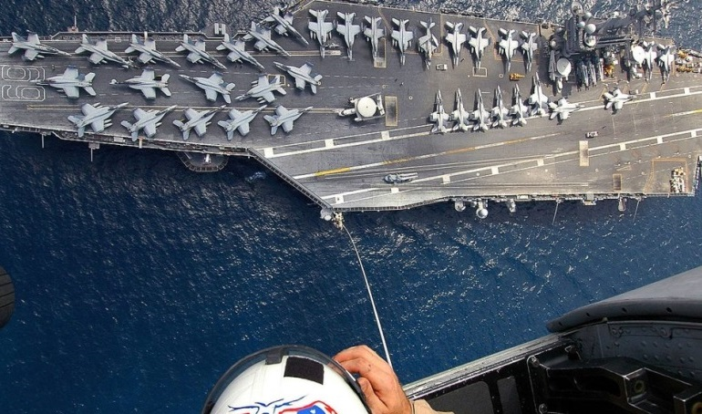 USS Eisenhower aircraft carrier docks in Crete
